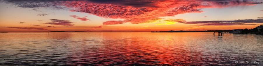 A panoramic image of a specatacular sunset over Cedar Key Florida